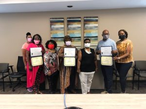 Aaron E. Henry Community Health Worker Training Graduates Hold their Certificates